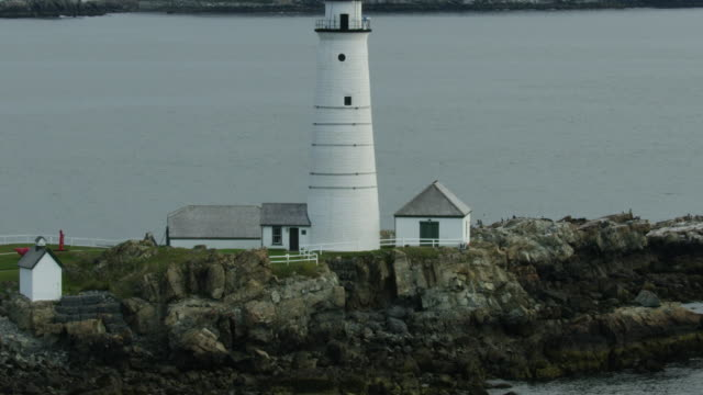 zooming out shot of the boston light on the little brewster island - new england usa stock videos & royalty-free footage