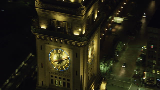 zooming out shot of the clock of the custom house tower at night - custom house tower stock videos & royalty-free footage