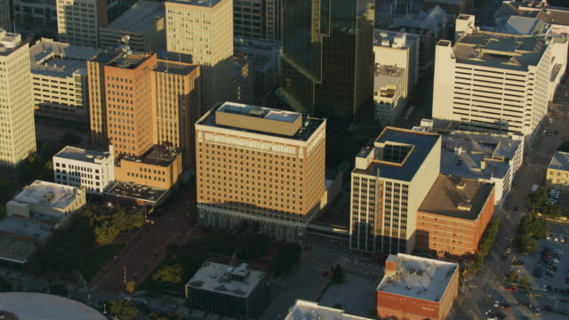 zooming out shot of the hilton fort worth at sunrise - street name sign stock videos & royalty-free footage