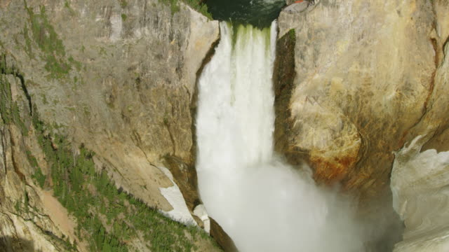 zooming out shot of the lower yellowstone falls - river yellowstone stock videos & royalty-free footage