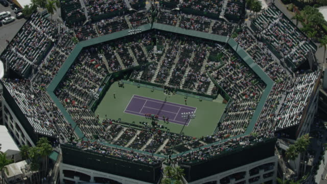 zooming out shot of the main tennis court before the game at the crandon park tennis center - tennis stock videos & royalty-free footage