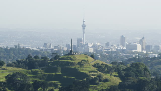 zooming out shot of the one tree hill with the sky tower in the background - one tree hill stock videos and b-roll footage