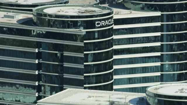 zooming out shot of the oracle sign atop the oracle corporation headquarters in redwood shores - silicon valley stock videos & royalty-free footage
