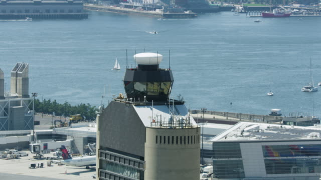 zooming out shot of the top of the logan control tower - boston massachusetts stock videos & royalty-free footage