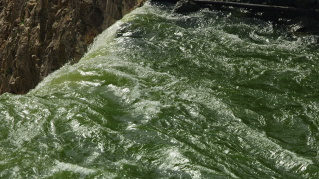 zooming out shot of the top of the lower yellowstone falls - river yellowstone stock videos & royalty-free footage