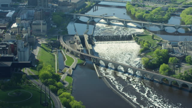 zooming out shot of the upper saint anthony falls lock and dam - river mississippi stock videos & royalty-free footage