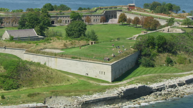 zooming out shot of tourists on the wall of fort warren - fortress stock videos & royalty-free footage