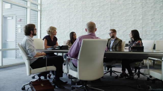 Zooming shot of business people having meeting in conference room / Provo, Utah, United States,