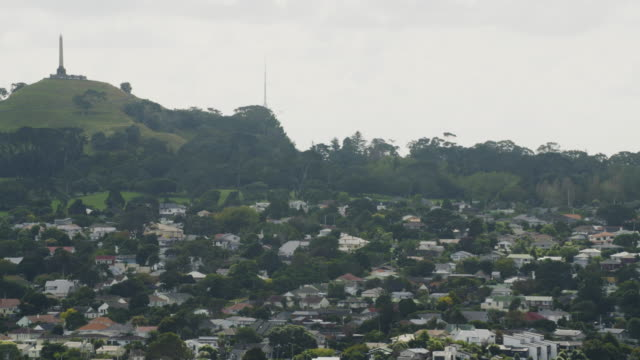 zooming-out shot of the one tree hill with an obelisk on the top - one tree hill stock videos and b-roll footage