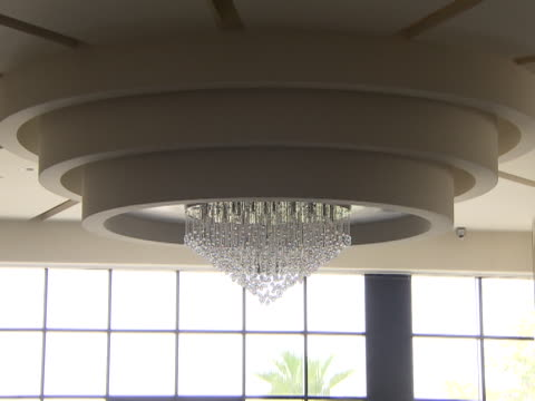 zoomout from a crystal chandelier to the restaurant in the lobby of the intercontinental hotel - intercontinental hotels group stock videos & royalty-free footage