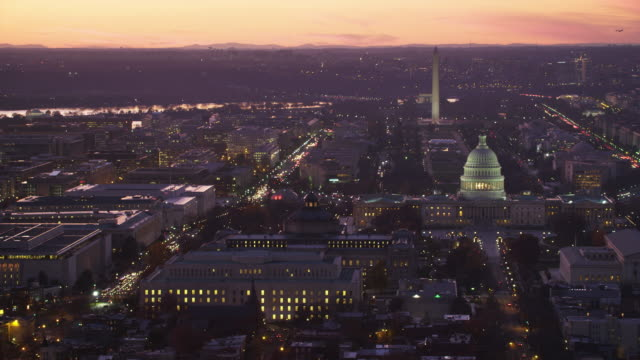 Zoom-out from Capitol Hill to wide view of Washington DC at dusk. Shot in 2011.