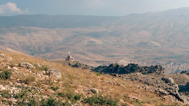 zoom-out of a christian shrine set high up in the arid expanse of the northern mount lebanon range. - christentum stock-videos und b-roll-filmmaterial