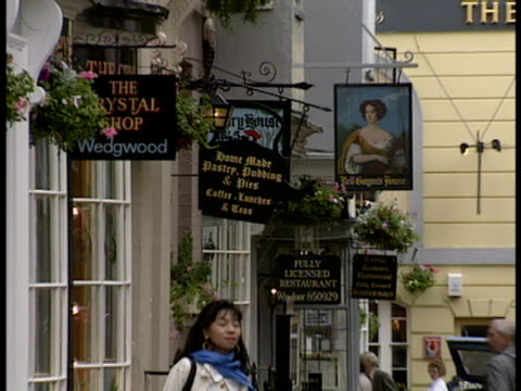 Zoomout of Church street in Windsor England featuring shops restaurants theaters and tourists