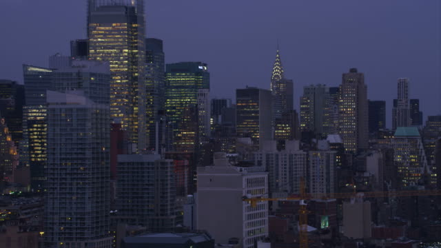 zoom-out on midtown manhattan skyscrapers at dusk. shot in november 2011. - artbeats stock videos & royalty-free footage