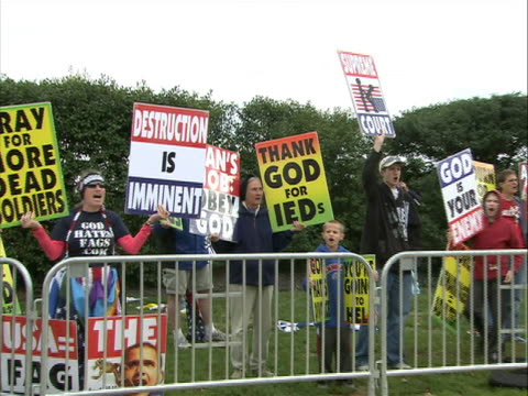 cu zoomout panright the westboro baptist church protesters demonstrate outside of arlington national cemetery the westboro church is a controversial... - baptist stock videos & royalty-free footage