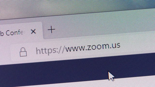 stockvideo's en b-roll-footage met zoom's url is typed in web browsers' address box on december 30, 2020. - zoom out