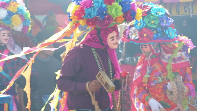 zoque coiteco carnival parade at chiapas village. mexican syncretism tradition - papier stock videos & royalty-free footage