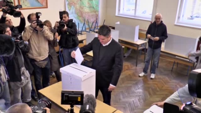 zoran milanovic croatian prime minister and leader of the croatian social democratic party casts his ballot for the parliamentary elections at a... - zagreb stock videos & royalty-free footage