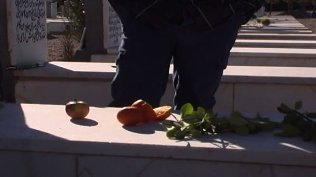 zoroastrian cemetery yazd. view of fruit and greenery left as offerings on a grave in the zoroastrian cemetery. - yazd province stock videos & royalty-free footage