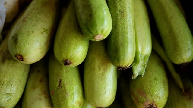 zucchini at the market,close up - courgette stock videos and b-roll footage