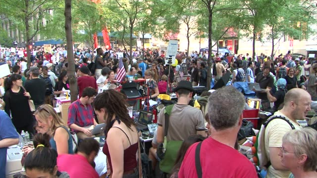 zuccotti park / liberty square / focus on organizers and people who are staying at the park overnight occupy wall street protests on october 09, 2011... - occupy protests stock videos & royalty-free footage