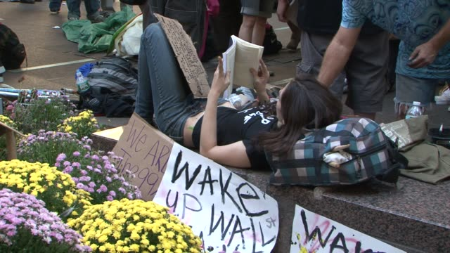 zuccotti park / liberty square / focus on people who are camped out at the park occupy wall street protests on october 09, 2011 in new york, new york - occupy protests stock videos & royalty-free footage