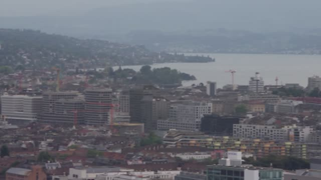 zurich ext various gvs of zurich skyline with lake zurich and mountains in distance - loch stock videos & royalty-free footage