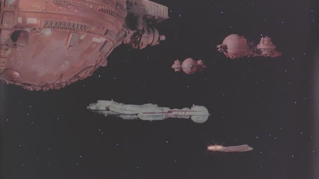 zykarian fleet around searcher - futuristic stock videos & royalty-free footage